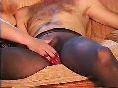 Homemade nylon fetish with huge cock teased through black pantyhose